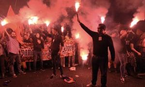 Anti-referendum protesters hold flares in Barcelona, 22 September 2017.
