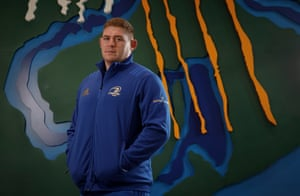 Tadhg Furlong, the Leinster and Lions player, in front of a specially commissioned artwork representing the rivers and land of the province combining together for the greater good at the Leinster training centre at the University College Dublin.