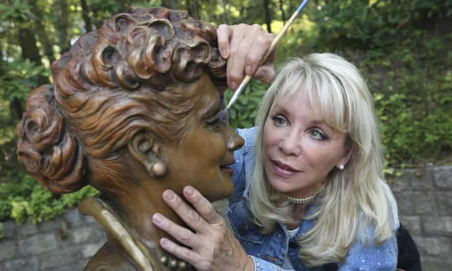 Carolyn Palmer prepares to apply a cold patina to her bronze statue of Lucille Ball.