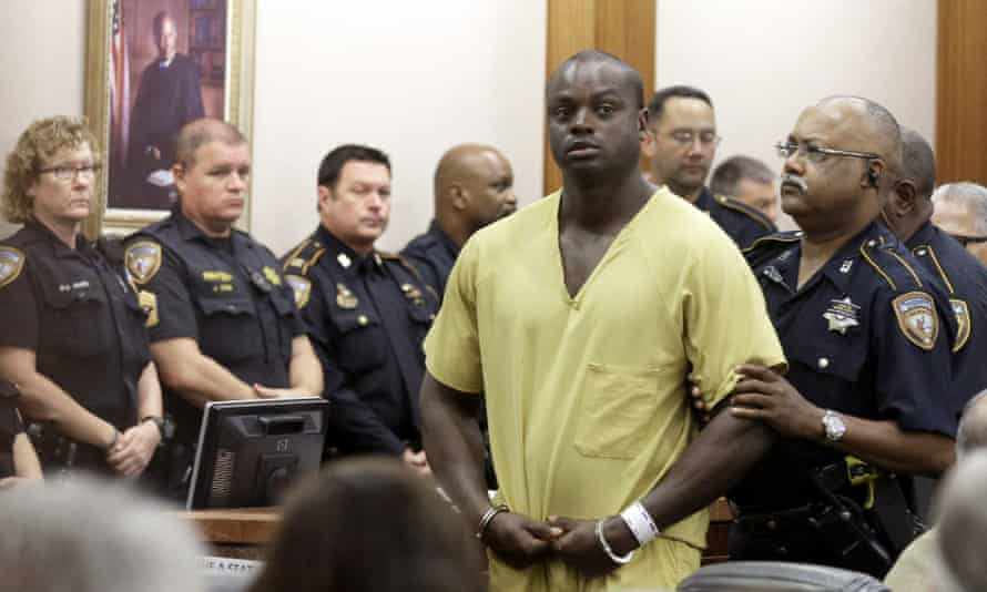 Shannon Miles is escorted out of a courtroom after the hearing in Houston on Monday.