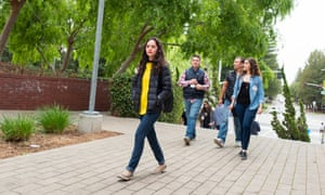 Google employees and visitors walk through the company's headquarters in Mountain View.
