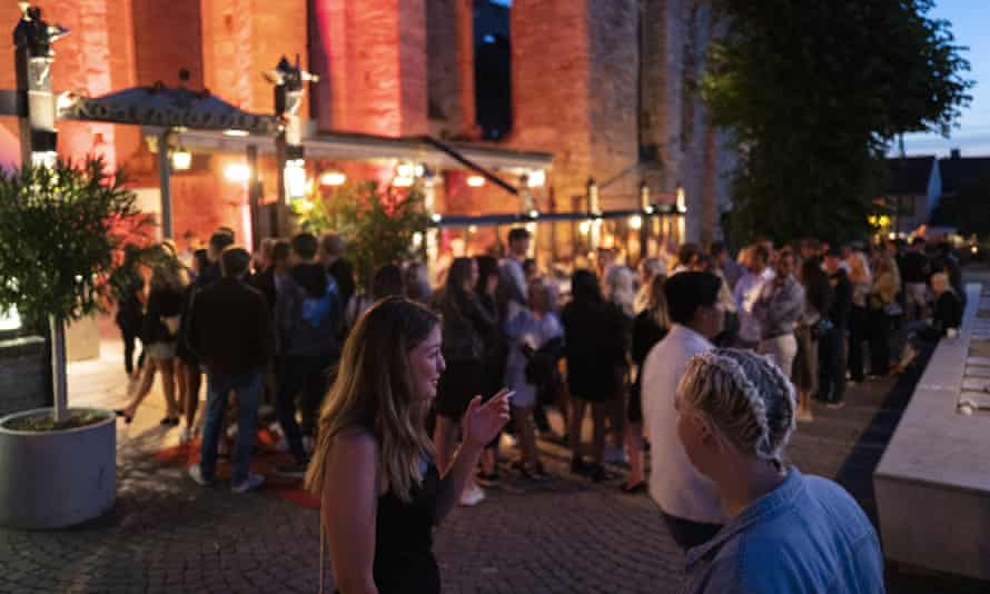 A group of people socialising outside at night in Gotland, Sweden