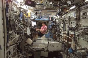 Astronaut Edward Lu playing a musical keyboard on the International Space Station