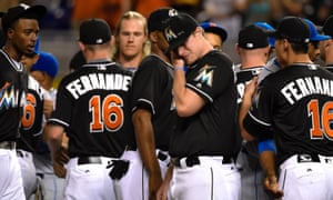 Miami Marlins starting pitcher Tom Koehler wipes tears away after greeting all the New York Mets players at the pitchers mound in honer of Marlins starting pitcher José Fernández who passed away from a boating accident in September.
