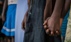 Girls hold hands at a ceremony to mark their release from armed groups in Yambio, south Sudan.