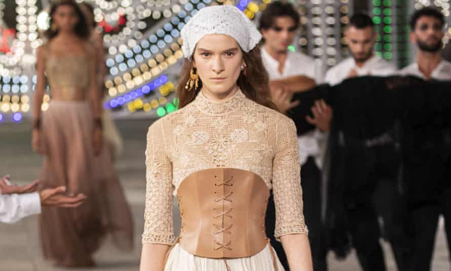 Model in white headscarf and caramel corset