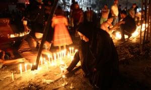 People light candles in Karada