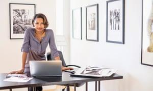Black woman using laptop in art gallery office