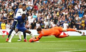 Antonio Ruediger of Chelsea holds off Emerson Royal of Tottenham Hotspur, as Kepa Arrizabalaga of Chelsea gathers the ball.