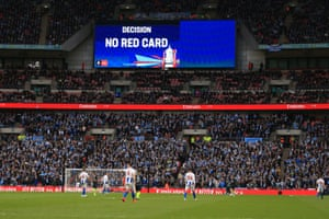 The VAR decision is shown on the giant screen during the FA Cup semi-final match.