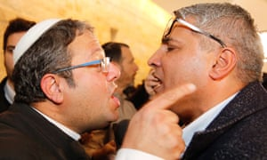 Jewish Power's Itamar Ben Gvir argues with the Israeli Arab candidate Ata Abu Medeghem after the supreme court in Jerusalem disqualified the party's leader from running in the election.