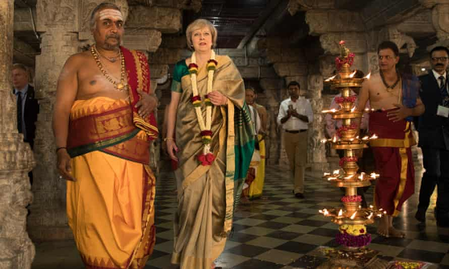 Theresa May wears a sari for a visit to a temple in Bangalore.  Reader Jullien Gaer suggests the Indian prime minister might want to respond in kind, when he comes to Britain.