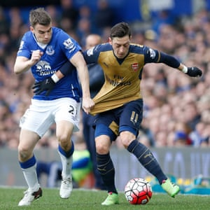 Seamus Coleman sturggles with Arsenal's Mesut Ozil.