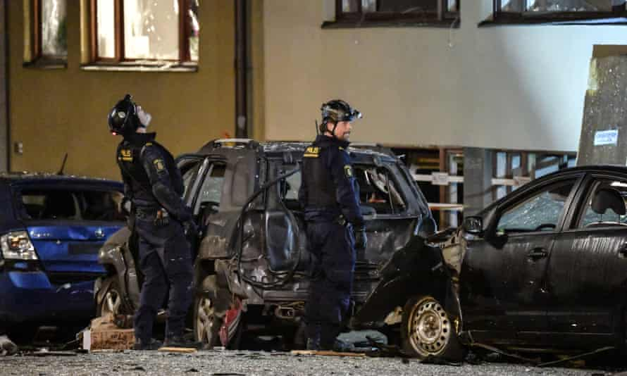 Police work at the scene of an explosion which caused damage to a residential building in central Stockholm, on 13 January.