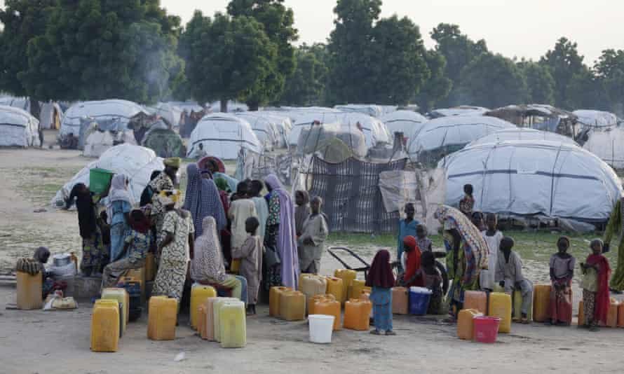 People displaced by Islamist extremists fetch water at Muna camp in Maiduguri, Nigeria