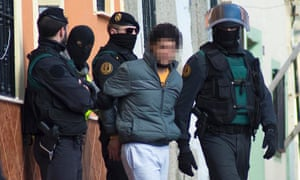 Spanish civil guards in Melilla escort a detained man