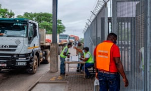 A man gets his temperature checked before entering South Africa at the Beitbridge border post between South Africa and Zimbabwe