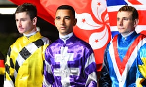 Oisin Murphy (left), pictured with João Moreira and Ryan Moore in Hong Kong, developed as an apprentice jockey under Andrew Balding.
