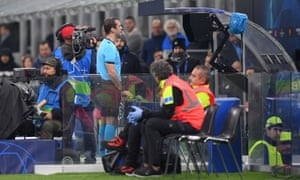 Referee Aleksey Kulbakov refers to VAR and awards a penalty.