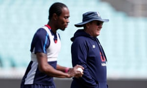 Trevor Bayliss (right) looks on as Jofra Archer practices in a nets session.