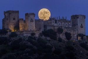 Moon behind castle of Almodovar in Cordoba, Spain