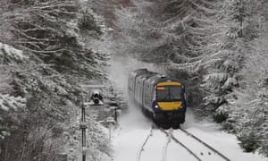 A train battles through the snow at Moy, near Inverness.
