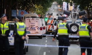 Police guard the site where a man attacked others in Melbourne.