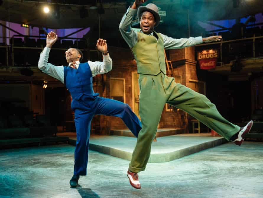 Fela Lufadeju as Benny Southwest and Ako Mitchell as Nicely-Nicely Johnson.