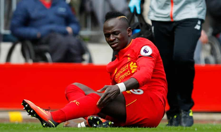 Sadio Mané in distress after suffering the injury against Everton at Anfield that has ruled him out for the rest of the season