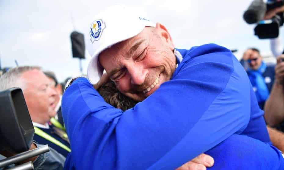 Thomas Bjørn, the Europe captain, gives a bear hug to Francesco Molinari