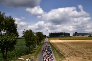 The peloton riding in the countryside during the third stage of the 106th edition of the Tour de France between Binche and Épernay.