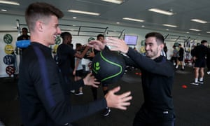 Mason Mount jokes around with Bournemouth's Lewis Cook at St George's Park on Tuesday.
