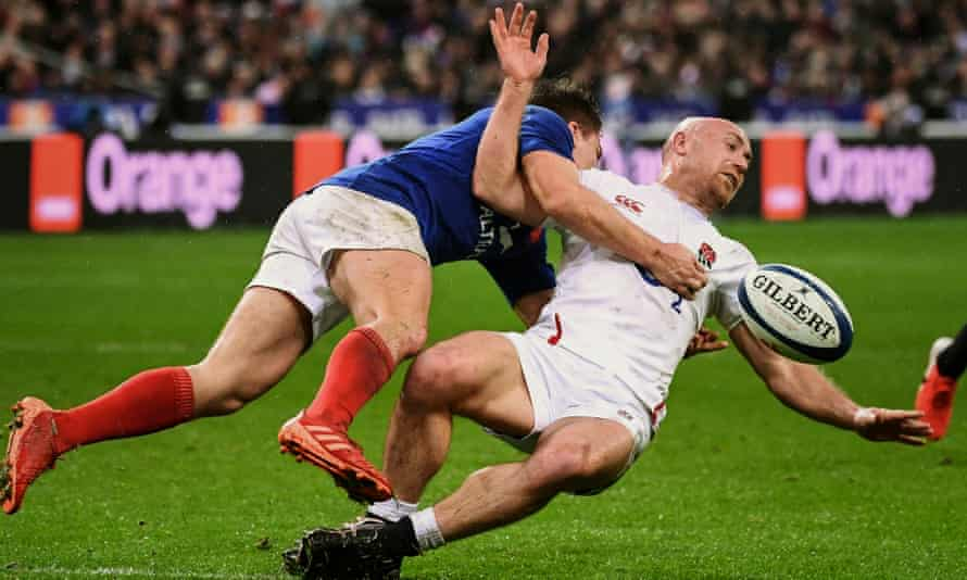 France's scrum half Antoine Dupont floors Willi Heinz of England during the Six Nations match at Saint Denis on Sunday.