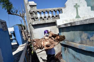 Haiti: A Vodou devotee in a trance takes a body from a grave
