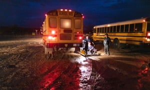Parents are forced to drop their children at the Sanostee chapter house because the buses are unable to navigate the muddy roads.