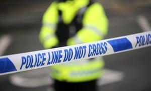 Police tape cordons off a crime scene