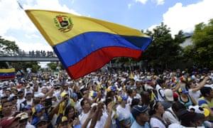 Venezuelan opposition activists attend a rally in Caracas, on Thursday.