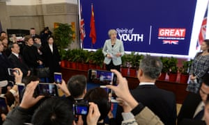 Theresa May at Wuhan University in China today, in front of a UK government logo proclaiming 'GREAT Britain'.