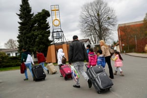 Syrian refugees arrive at the camp for refugees and migrants in Friedland, Germany