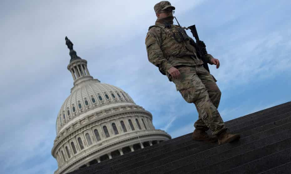 A member of the national guard provides security at the US Capitol.