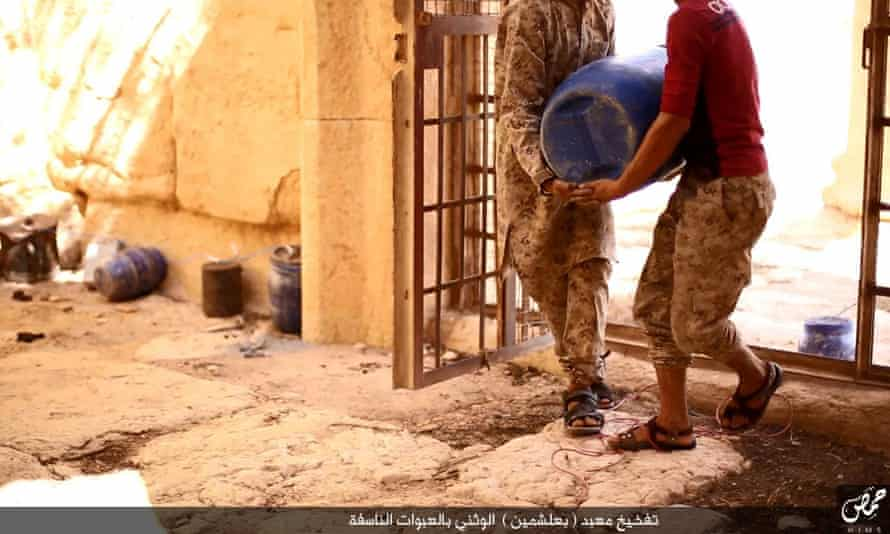 Images published by Isis believed to show two men carrying explosives into Baal Shamin.