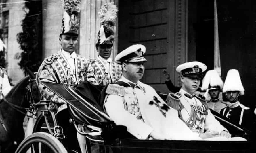 Carol II, seated left in carriage, with his son, Crown Prince Michael, in June 1939. They were on their way to the opening of parliament.