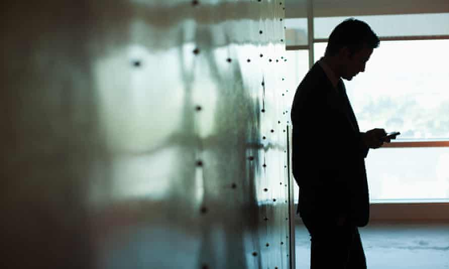 Silhouette of businessman using mobile phone