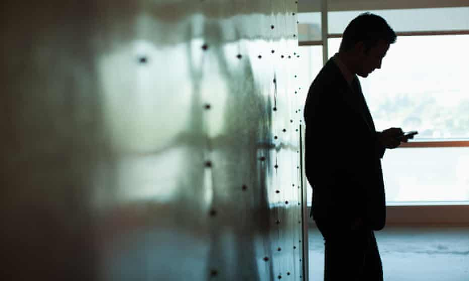 Silhouette of businessman using a mobile phone
