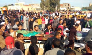 Egyptians carry some of the victims of last week's attack on the Rawdah mosque in northern Sinai.