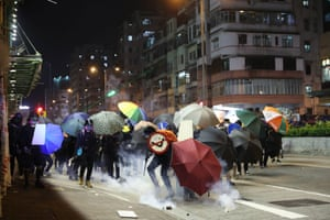 Protesters react to tear gas fired by riot police in the Sham Shui Po district of Hong Kong.