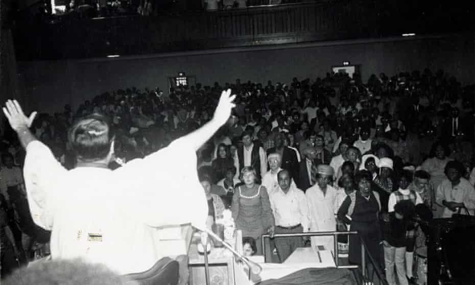 Jim Jones speaks to a crowd of followers.