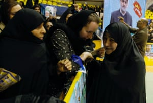 Iranian candidate Soheila Jelodarzadeh, on the right, talks to supporters during election campaign.