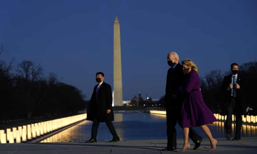 The Bidens at a Covid memorial at the Lincoln Memorial reflecting pool on 19 January.