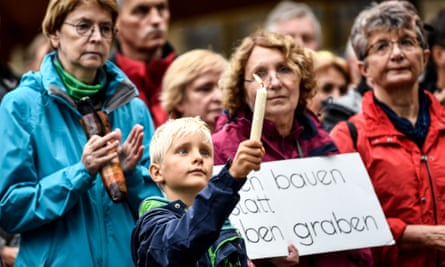 People attend a demonstration called 'Chemnitz citizens set a democratic signal against violence and xenophobia', in Chemnitz.